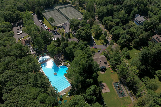 Aerial view of the swimming pool and building
