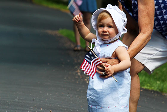 Infant at a 4th of July parade