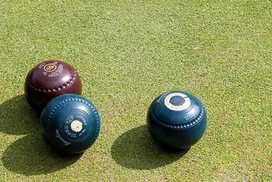 Lawn bowling balls sitting on grass