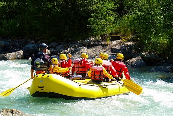 A family white water rafting